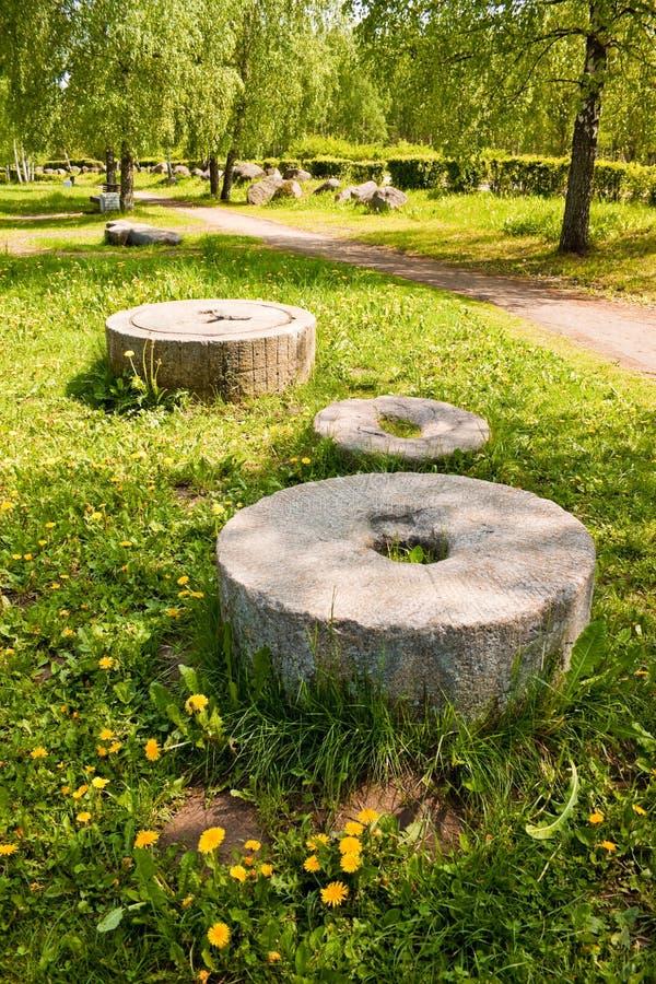 Ancient millstones. In park of boulders, Minsk, Belarus stock photography