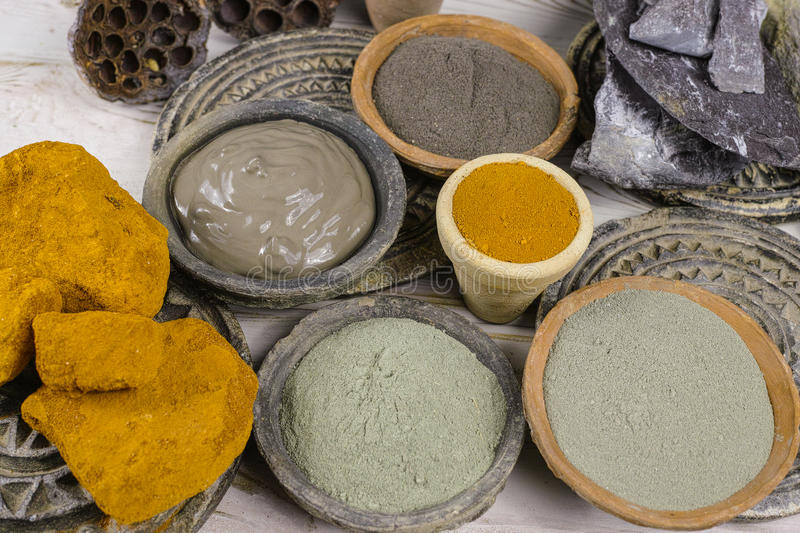 Ancient minerals - black, green, blue, ochre clay powder and mud royalty free stock photo