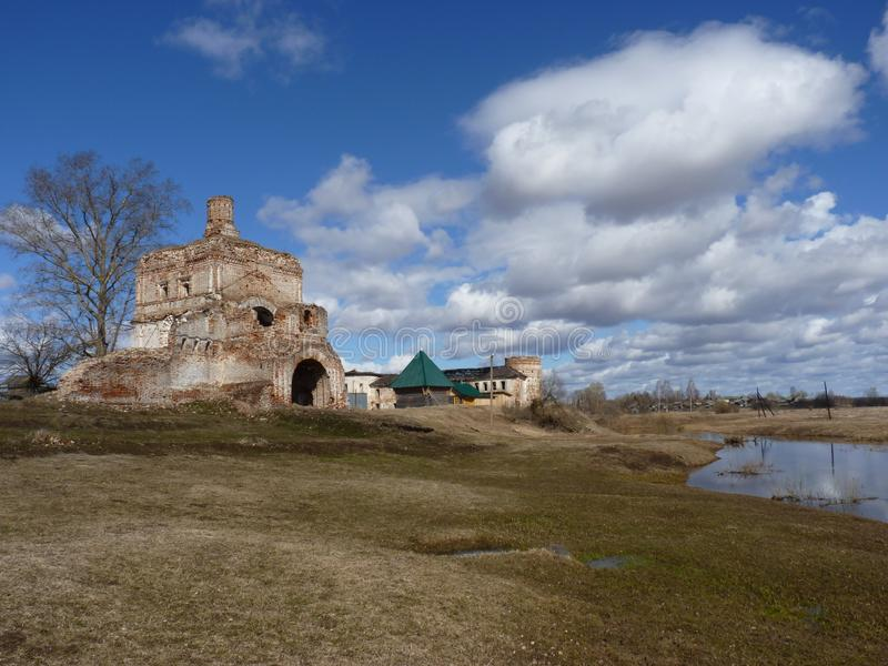 The ancient monastery on the bank of river stock image