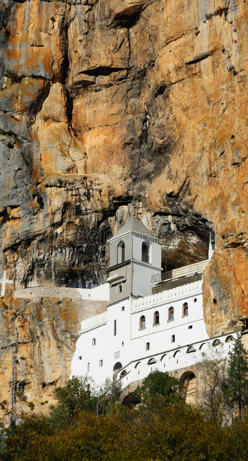 Ancient monastery in high mountain. Montenegro. During centuries the unique ancient monastery was hided inside of top of the high mountain. He was renovated in stock photography