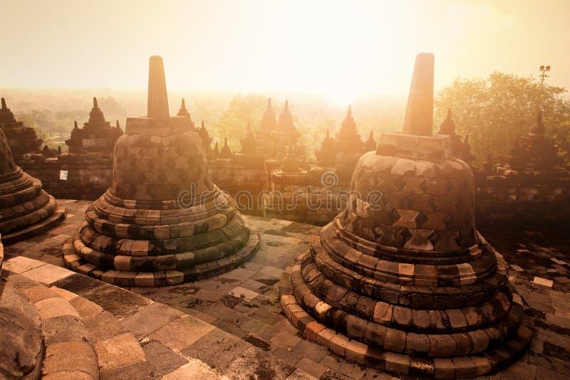 Ancient monument of Borobudur Buddhist temple at sunrise, Yogyakarta, Java Indonesia. stock photography