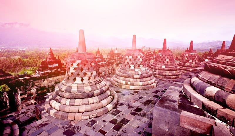 Ancient monument of Borobudur Buddhist temple at sunrise, Yogyakarta, Java Indonesia. stock photo