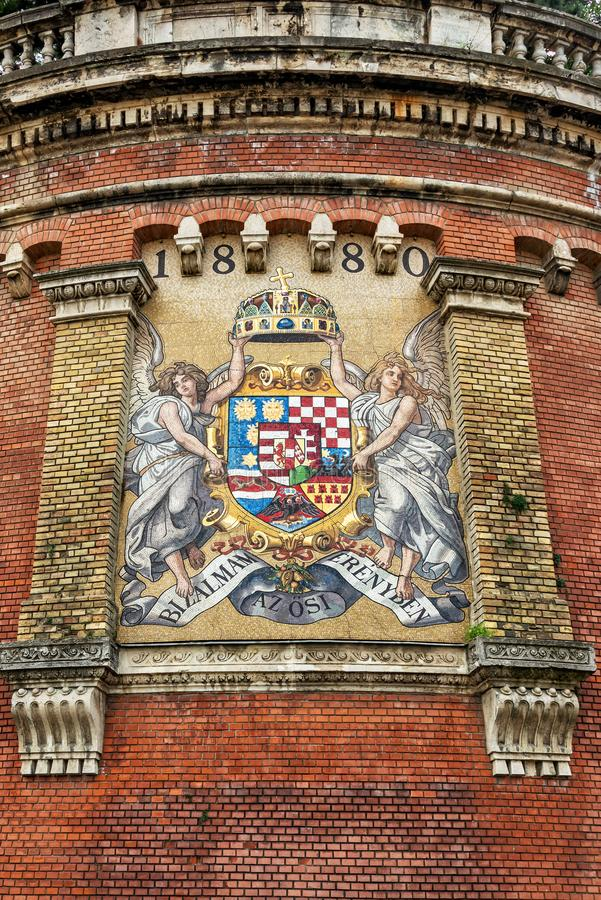Ancient mosaic coat of arms of Kingdom of Hungary in Budapest stock images