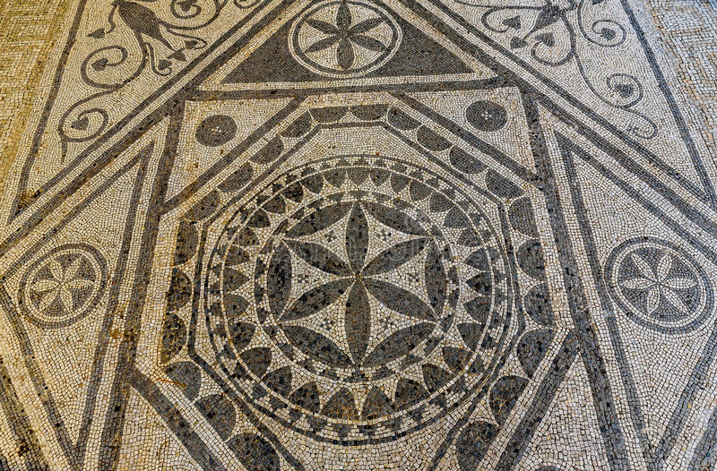 Ancient Mosaic ruins close up in Roman villa in Risan, Monteneg royalty free stock images