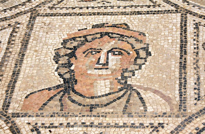 Ancient mosaic with woman face, Volubilis, Morocco royalty free stock images