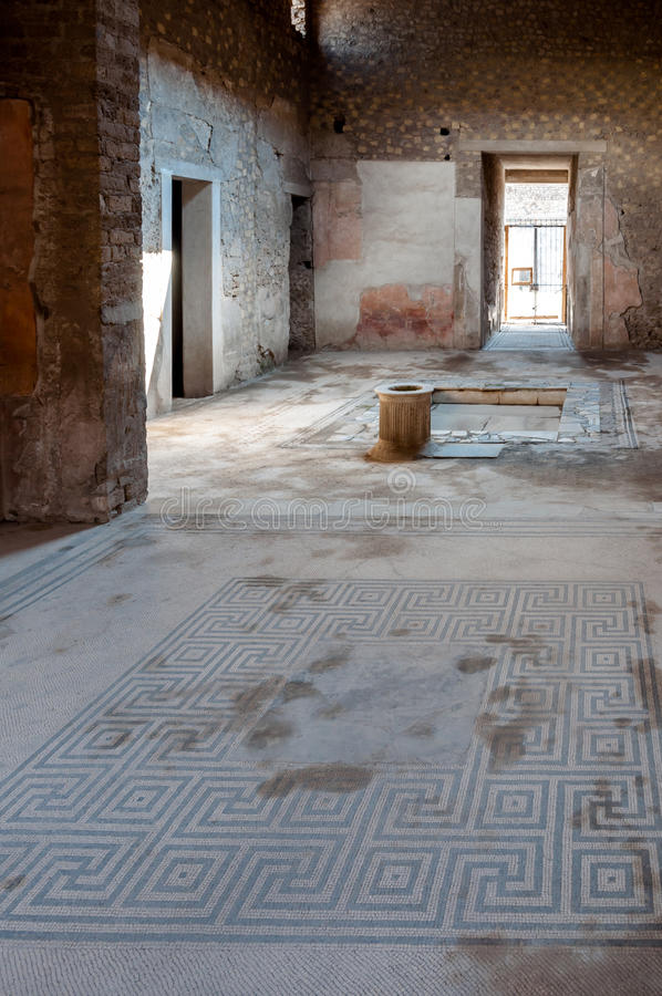 Ancient mosaics and interior of a house at Pompeii. Pompeii was destroyed and buried with ash and pumice after Vesuvius eruption in 79 AD stock images
