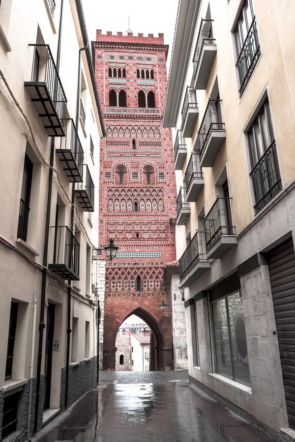 The ancient Mudejar style tower, Spain, Apr.2019. The ancient Mudejar style tower - historic town of Teruel, in the mountainous Aragon region of eastern Spain stock images