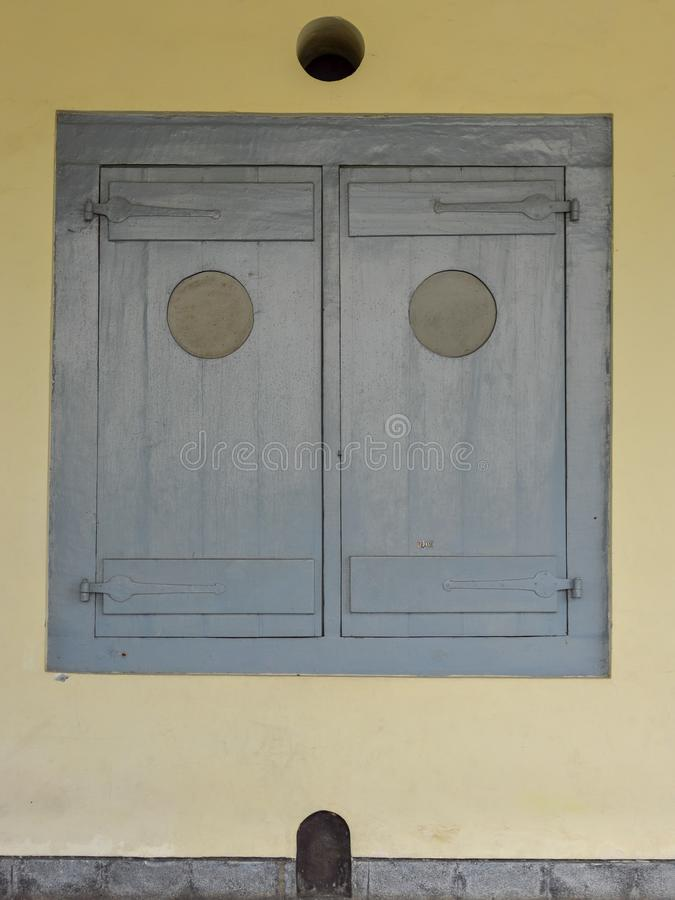 Ancient gray window in closed position royalty free stock photos