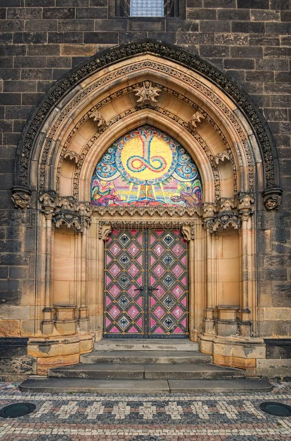 Ancient Neo Gothic Church of Saint Peter and Paul in Vysehrad `Upper Castle`. Ornamented entrance doors to Basilica. Prague, Czech Republic stock image