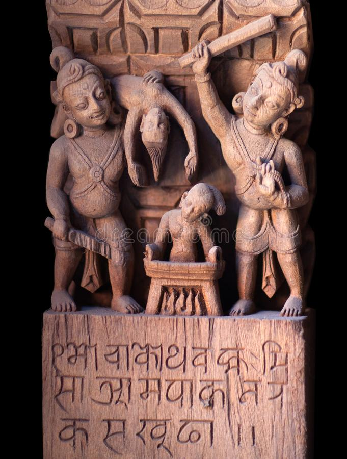 Ancient Nepalese wooden carving in Patan, Nepal. Ancient Nepalese wooden carving at the column in palace on Durbar square in Patan, Kathmandu valley, Nepal stock image