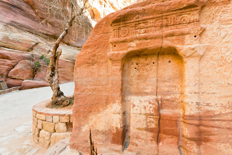 Ancient niche in wall of Siq gorge, Petra,. Ancient niche in sandstone mountain wall of Siq gorge, Petra, Jordan royalty free stock photography