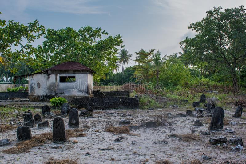 Ancient old abandoned cemetery with crypt and graves at the tropical island stock images