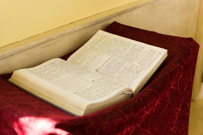 Ancient old Testament book lies on the altar.  stock images
