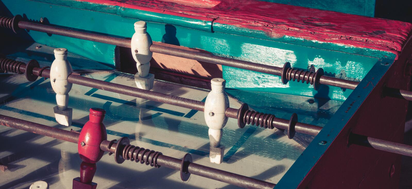 Ancient old wood classic aged Foosball table or table soccer with vintage effect photo style. royalty free stock photo