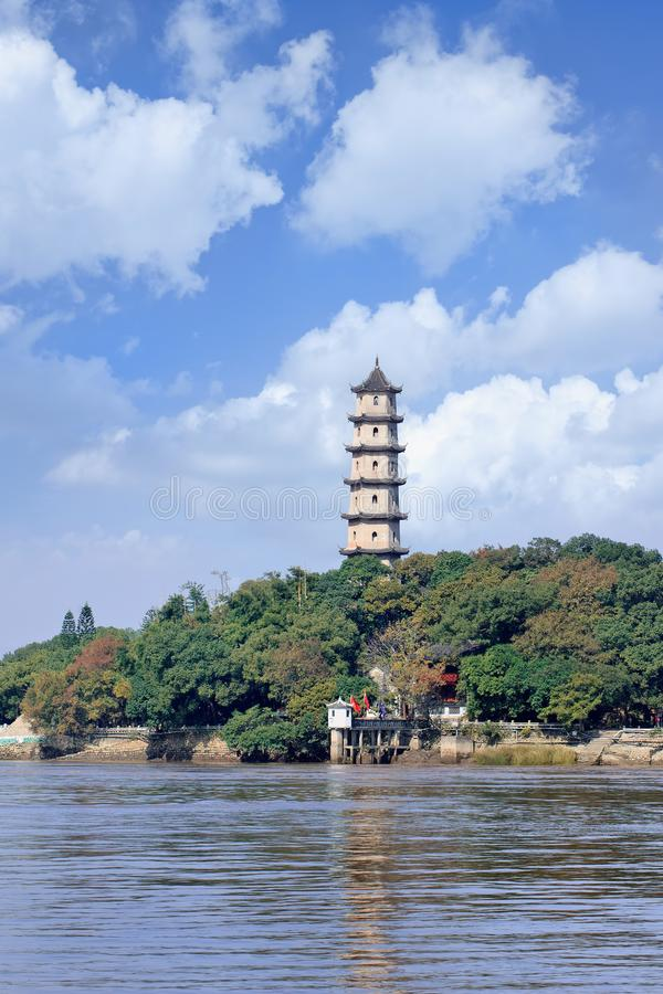 Ancient pagoda on Jiangxin Island in Oujiang River, Wenzhou, China. Ancient pagoda against a blue cloudy sky on Jiangxin Island in Oujiang River, Wenzhou, China stock image