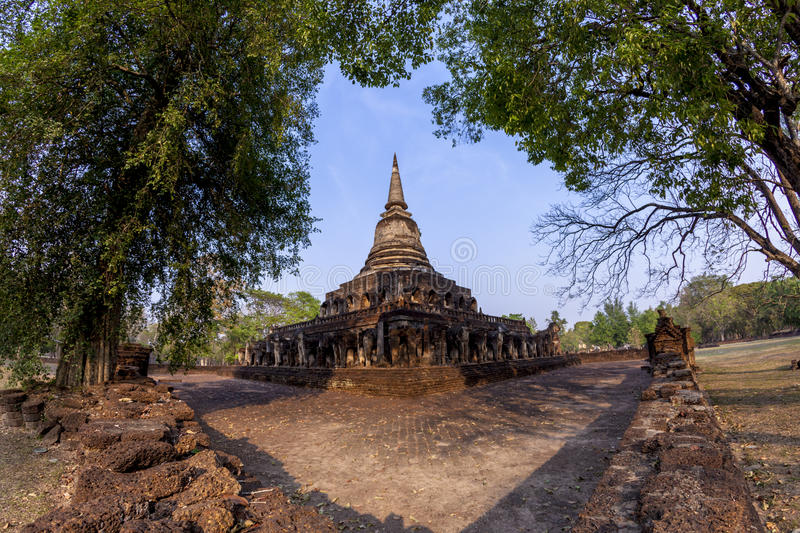 Ancient pagoda with attached elephant statues at Wat Chang Lom a. T Si Satchanalai Historical Park, Sukhothai, Thailand : Unesco world heritage stock photos