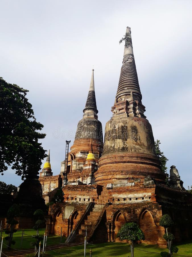 Ancient pagoda in Ayutthaya, Thailand. Travel, buddha, sky, cloud, tree, green royalty free stock images