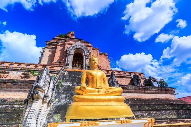 Ancient pagoda and buddha statue at Wat Chedi Luang temple in Chiang Mai, Thailand. Ancient pagoda at Wat Chedi Luang in Chiangmai province of Thailand stock image