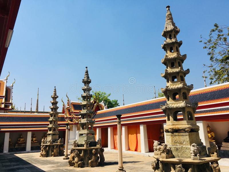 Ancient Pagoda decoration in Wat Pho temple in Bangkok, Thailand. Ancient Pagoda and Stupas decorate around external in Wat Pho temple in Bangkok, Thailand stock images