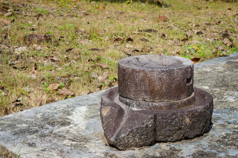 Ancient pan or device used at tin pewter castings. Old pan used at tin mining works. Phuket, Thailand royalty free stock photos