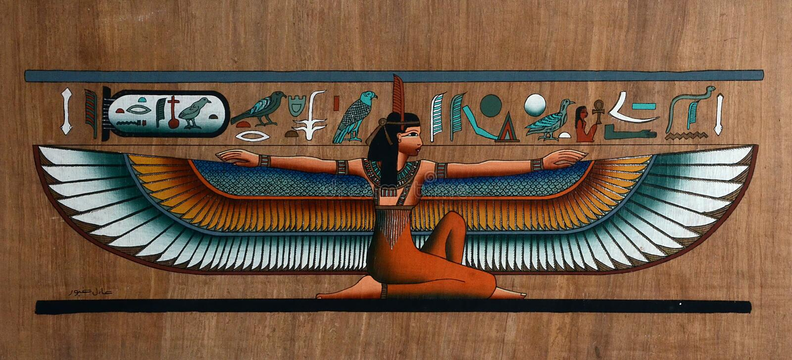Egyptian papyrus with winged goddess stock photography