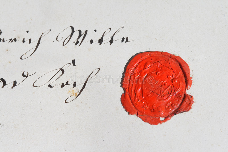 Ancient parchment manuscript with wax seal royalty free stock photo