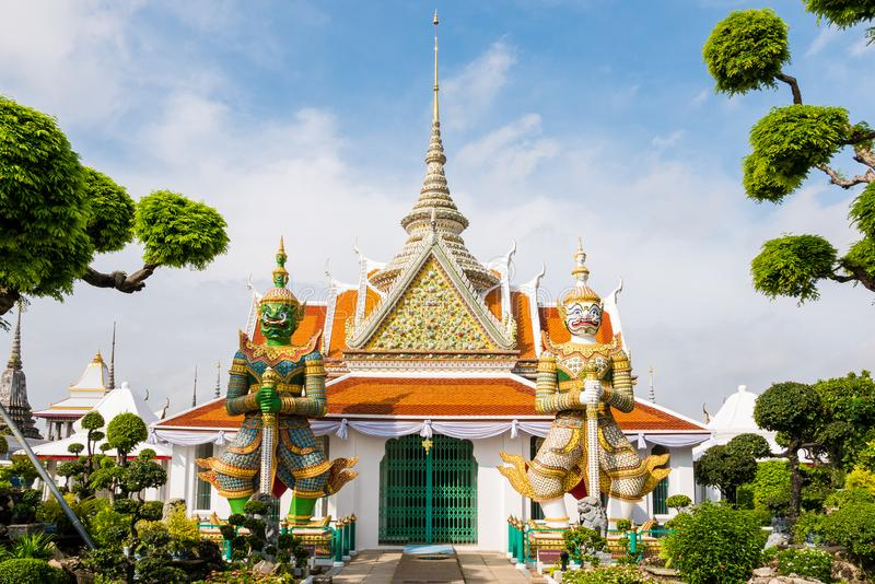 Ancient Pavilion with Giant statues in Wat Arun garden, Temple of Dawn, Bangkok, Thai. royalty free stock image