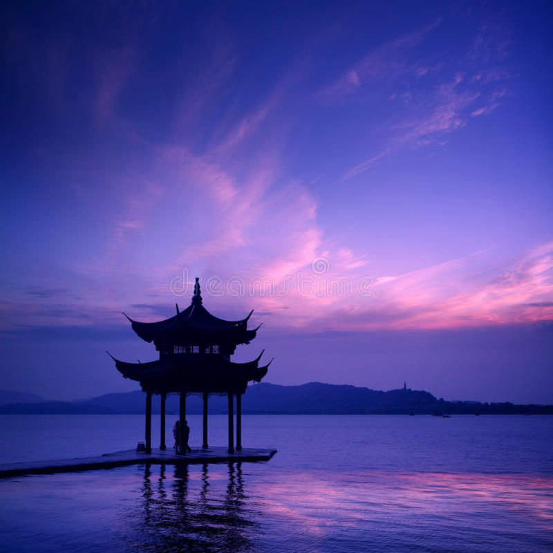 Ancient pavilion on the west lake. With sunset in hangzhou,China royalty free stock photography