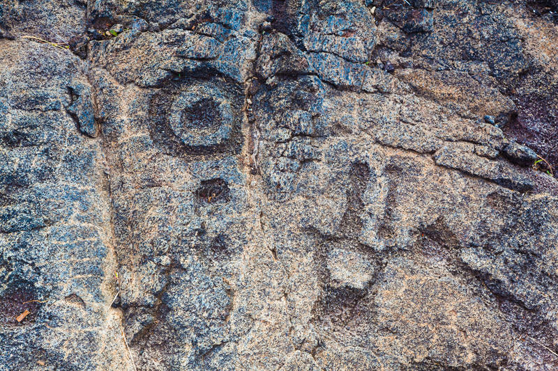 Ancient petroglyphs. On lava along the trail in Hawaii Volcanoes National Park, Big Island stock photography