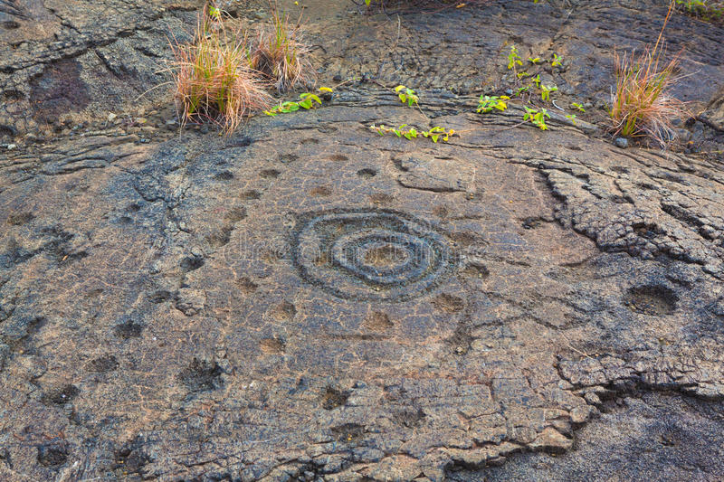 Ancient petroglyphs. On lava along the trail in Hawaii Volcanoes National Park, Big Island royalty free stock image