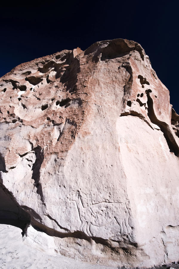 Ancient Petroglyphs on the Rocks at Yerbas Buenas in Atacama Desert in Chile. Ancient Petroglyphs carved on the red Rocks at Yerbas Buenas in Atacama Desert in stock photography