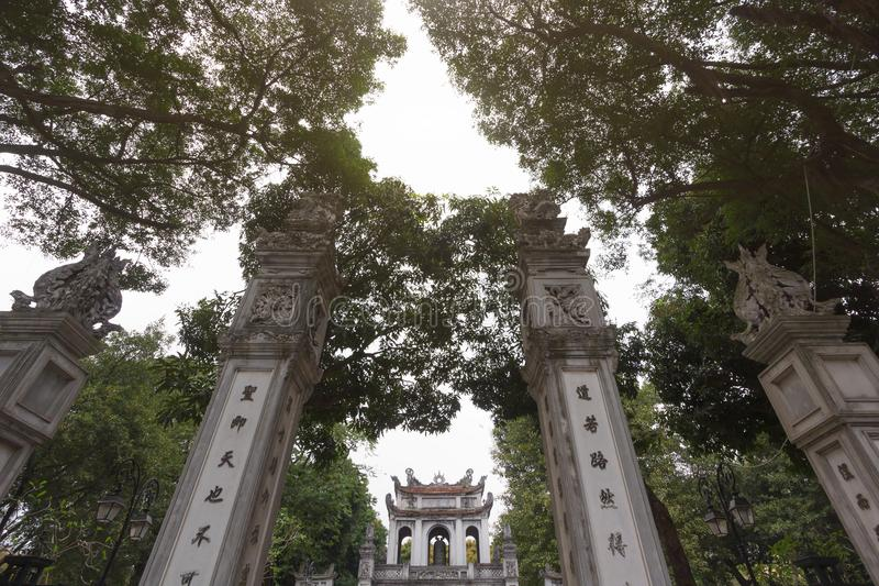 Ancient pillars at the main entrance of the Temple of Literature - Vietnam`s first national university built in 1070 stock photo