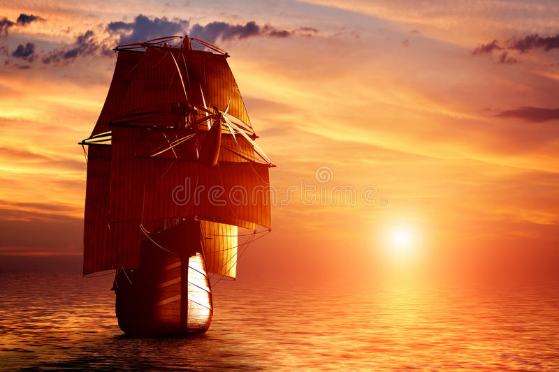 Ancient pirate ship sailing on the ocean at sunset stock image