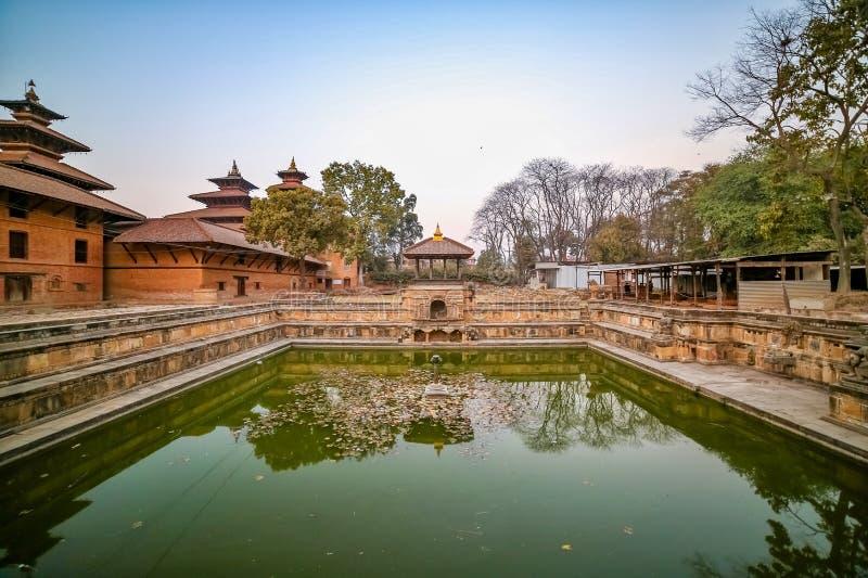 Ancient pond at Patan Durbar Square premises in Kathmandu, Nepal. A UNESCO World Heritage Site. Ancient pond at Patan Durbar Square premises in Kathmandu, Nepal royalty free stock photo