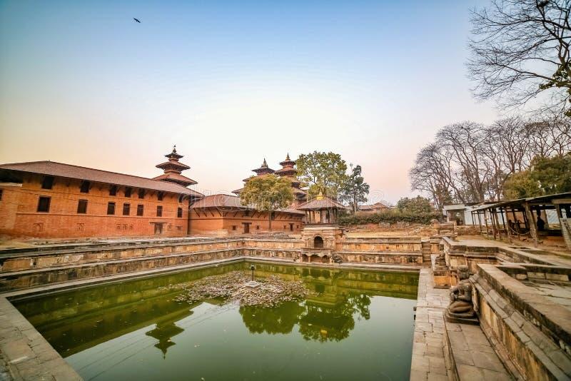 Ancient pond at Patan Durbar Square premises in Kathmandu, Nepal. A UNESCO World Heritage Site. Ancient pond at Patan Durbar Square premises in Kathmandu, Nepal stock photos