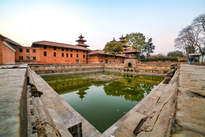 Ancient pond at Patan Durbar Square premises in Kathmandu, Nepal. A UNESCO World Heritage Site. Ancient pond at Patan Durbar Square premises in Kathmandu, Nepal stock photo