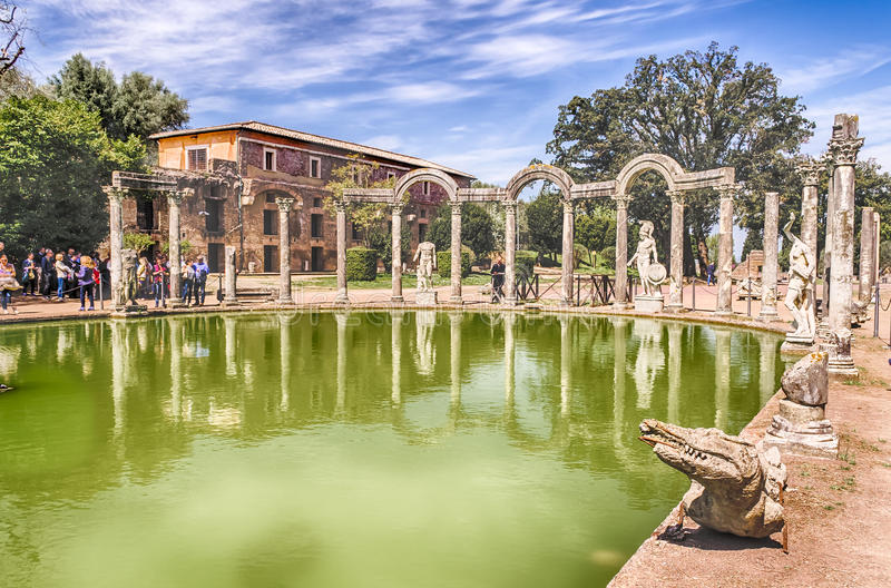 The Ancient Pool called Canopus in Villa Adriana, Tivoli. The Ancient Pool called Canopus, surrounded by greek sculptures in Villa Adriana (Hadrian's Villa) royalty free stock photography