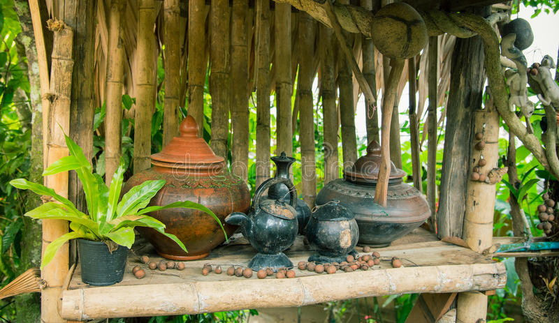 Ancient pottery pot for drinking water in Northern Thailand. On the bamboo shelf royalty free stock images