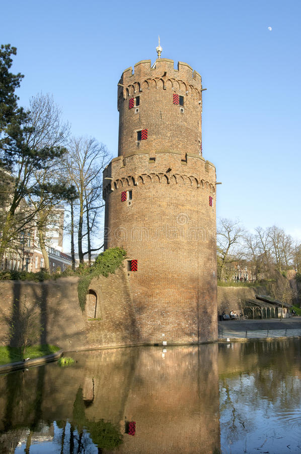 Ancient Powder Tower and city wall in park, Nijmegen royalty free stock image