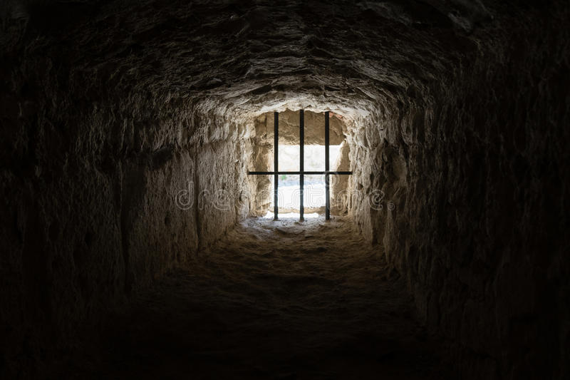Ancient prison window royalty free stock image