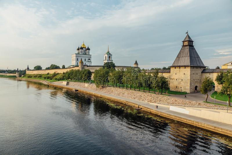 Ancient Pskov Kremlin on river bank, Trinity church, day time royalty free stock images