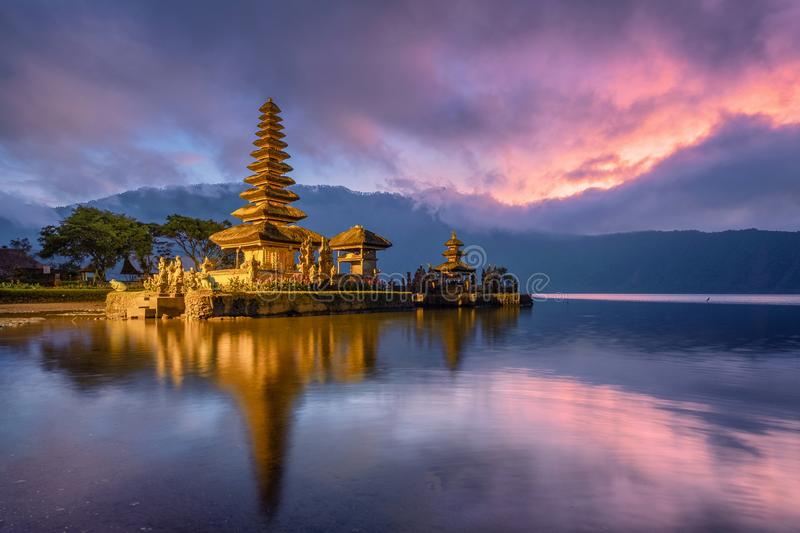 Ancient Pura Ulun Danu Bratan temple reflection with colorful sk. Y at sunrise. Bali, Indonesia royalty free stock photo