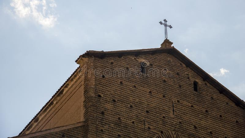 An ancient quarter of Bologna, Italy . San Petronio basilica, a view from the rear. The cross is on the top. royalty free stock photos