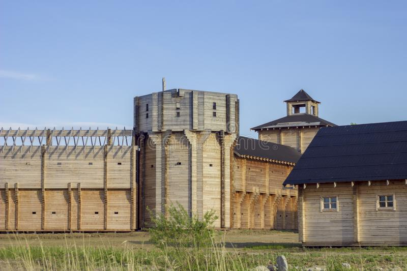 Ancient reconstruction of a wooden fortress with high walls and towers royalty free stock photography