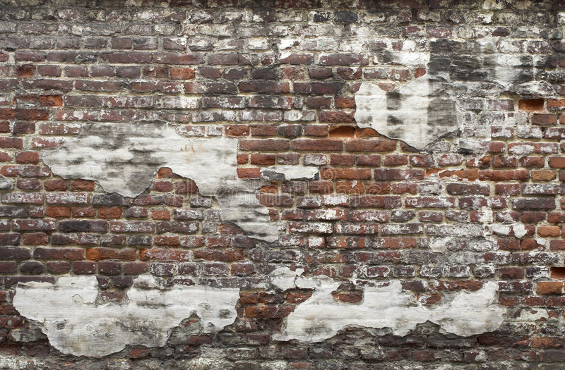Ancient red brick wall with remaining plaster spots