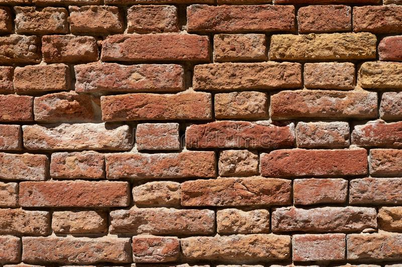 Ancient red brick wall texture background, sunlight royalty free stock photography