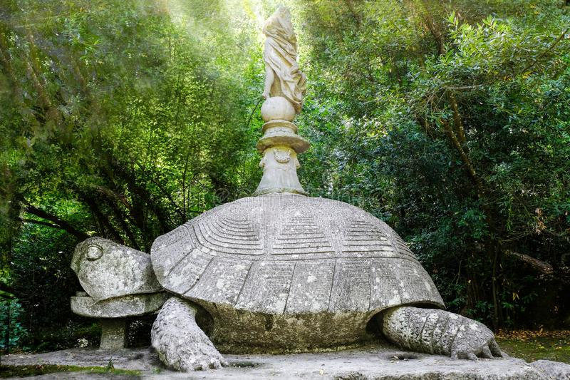 Ancient renaissance sculpture Turtleat the famous Parco dei Mostri, also called Sacro Bosco or Giardini di Bomarzo. Monsters park. stock image