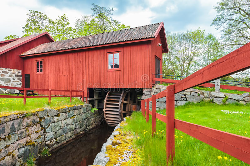 Ancient restored water mill in Huseby Bruk in Sweden. HUSEBY BRUK, SWEDEN - MAY 20, 2015: Ancient restored water mill in Huseby Bruk in the province of Smaland royalty free stock photo
