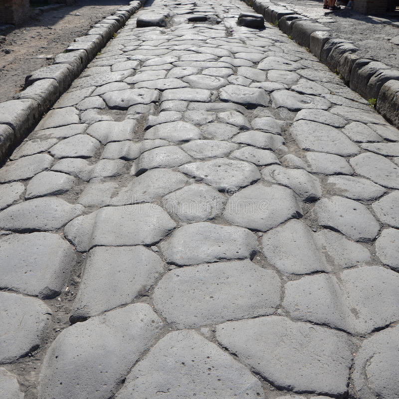 Ancient road with original ruts in the stone, Pompeii. Italy royalty free stock images