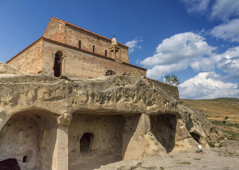 Ancient Rock-hewn town Uplistsikhe and Uplistsuli church . Georgia. Ancient Rock-hewn town Uplistsikhe. Georgia. Uplistsuli church or church of Prince. UNESCO royalty free stock images